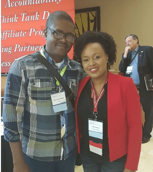 See Why A Nigerian Lady Refused To Take Pictures With Pretty Wife Of US Music Legend.